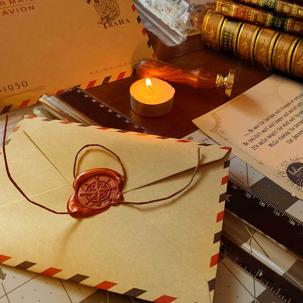 A Capsule Tale story by Nelson, sealed with red wax in a brown travel envelope, sitting on a writing desk