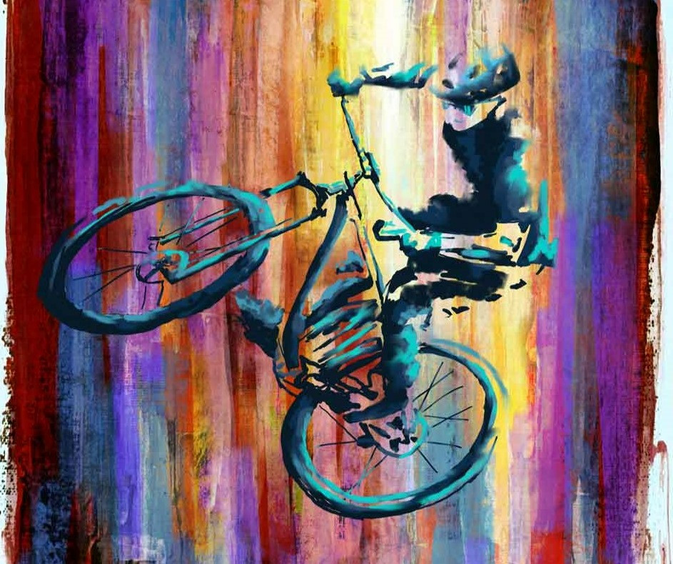 Abstract portrait of leaping mountain biker against a colorful painted background
