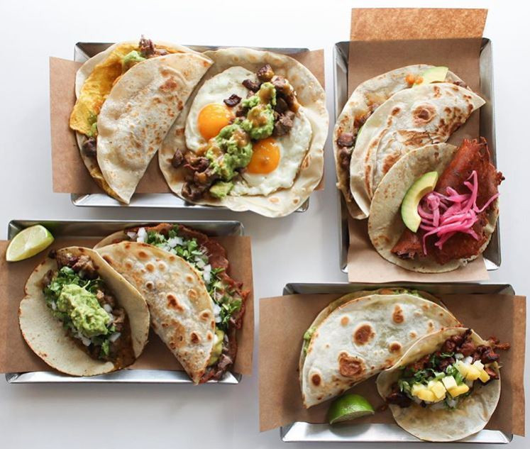 Four baskets of different varieties of soft tacos, featuring eggs, steak, spinach and more, from MexA Steak Tacos in Lousiville, KY.