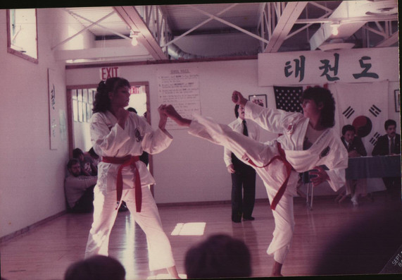 My sister (left), me (right), red belt degree test, late 80's