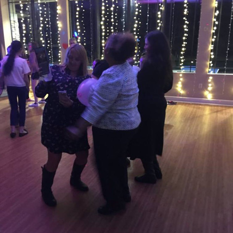 ladies dancing at fund raiser.jpg