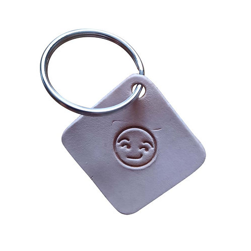 Flirtatious emoji square leather keyring