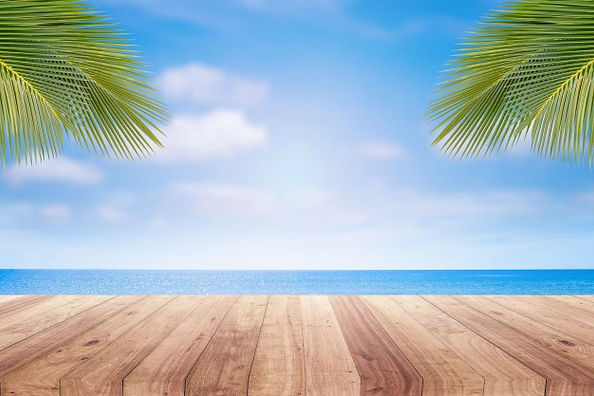 wooden-table-top-blurred-beach-backgroun