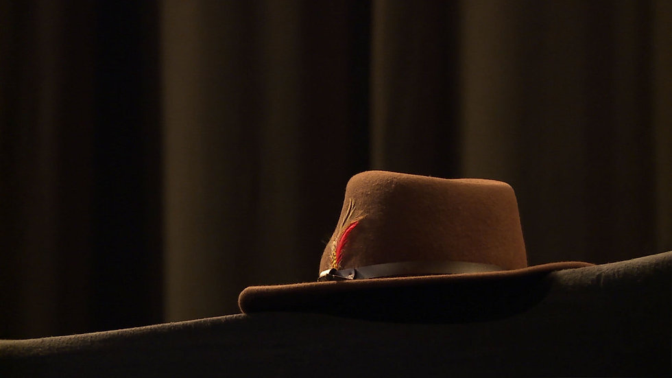 Judge Harry Pregerson's hat sits on podium at packed Shrine Auditorium for a ceremony to celebrate his life