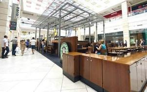 Starbucks pleacă din AFI, din Piaţa Victoriei şi din Promenada, dar îşi face loc la parterul Hanului