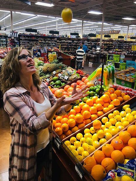 Jennifer Tossing Fruit.jpg