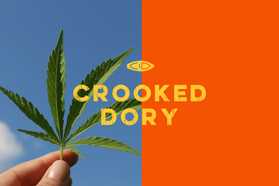 Crooked Dory cover. Hand holding a marihuana leaf, on top it reads Crooked Dory