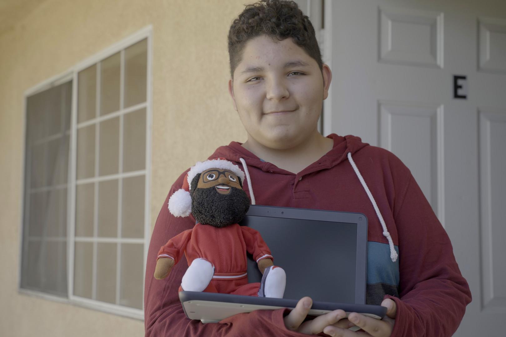Julian receives his Chromebook from the Black Santa crew