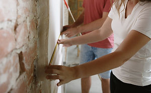 young-couple-doing-apartment-repair-toge