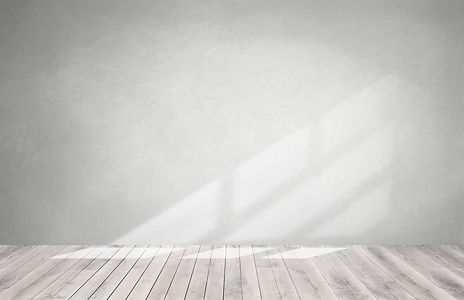 gray-wall-in-an-empty-room-with-wooden-floor.jpg