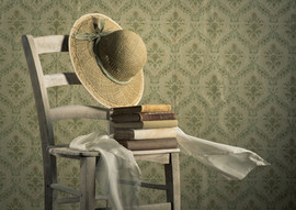 Old Books On A Chair With Straw Hat.jpg