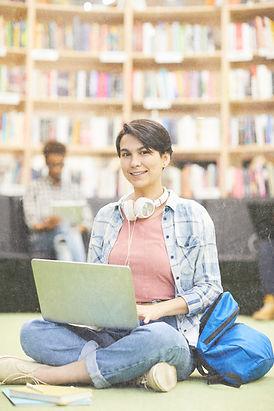 student-girl-using-online-resource-on-la