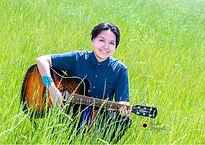 senior girls outdoor poses with guitar o