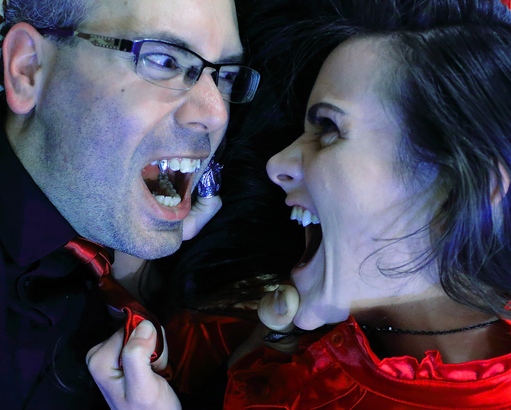 Vampire couple fang fight.
