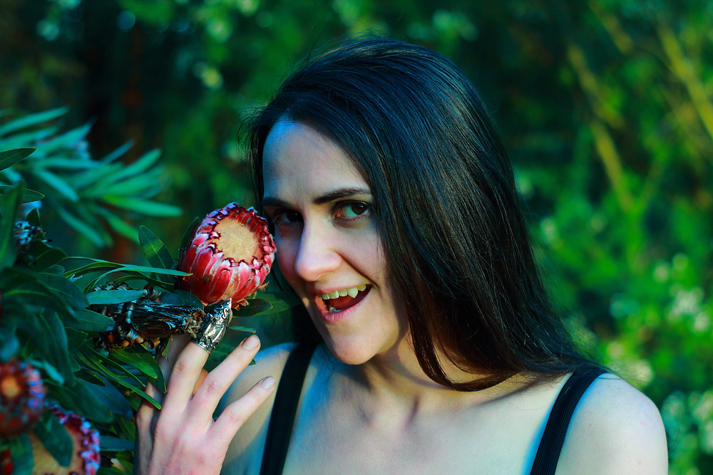 Vampire with Australian flower, native protea.