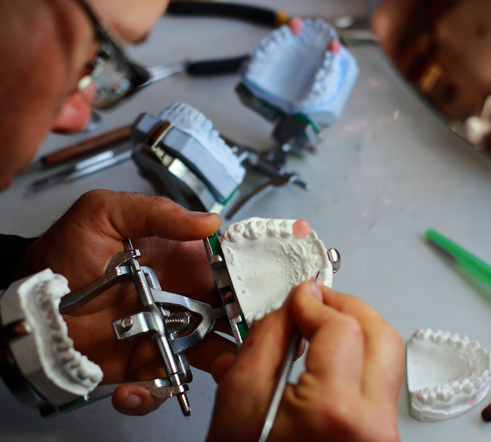 Waxing up some custom made vampire teeth