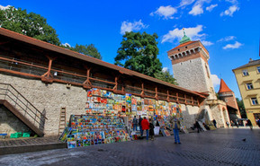 Medieval City Walls surrounding the old town - today arts gallery with local artists catering to millions of visitors exploring the medieval streets of Krakow