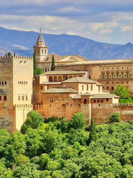 The Alhambra:  a palace and fortress complex on the fill overlooking Granada. It was originally constructed as a small fortress in 889 CE and then renovated and rebuilt in the mid-13th century by the Nasrid emir Mohammed ben Al-Ahmar of the Emirate of Granada, who built its current palace and walls with many beautiful, intricate details. One of many symbolic landmarks of Andalusia and its islamic heritage.