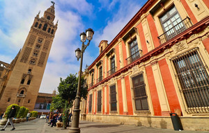 Shortly after Seville's conquest by Ferdinand III, the city's mosque was converted into the Christian cathedral with the 105 m Giralda tower (former minaret tower) overlooking the entire city.
