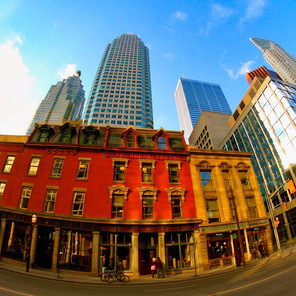 Modern Skyscrapers dominating over historic buildings on Yonge street in Toronto, Canada