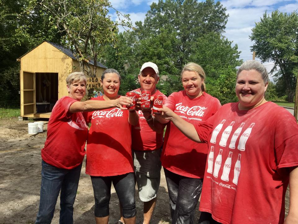 Coke Cola Crew after Sanding having a co