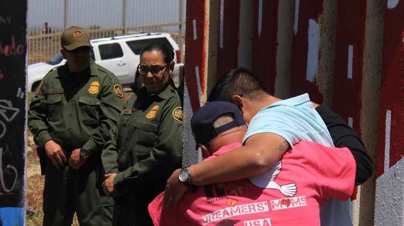 Family momentarily reunited at Friendship Park, Mex/USA Border