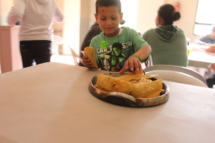 Child in migrant shelter