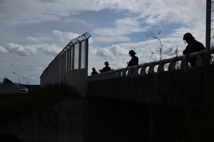 policia Border guards in the jungle refugee camp