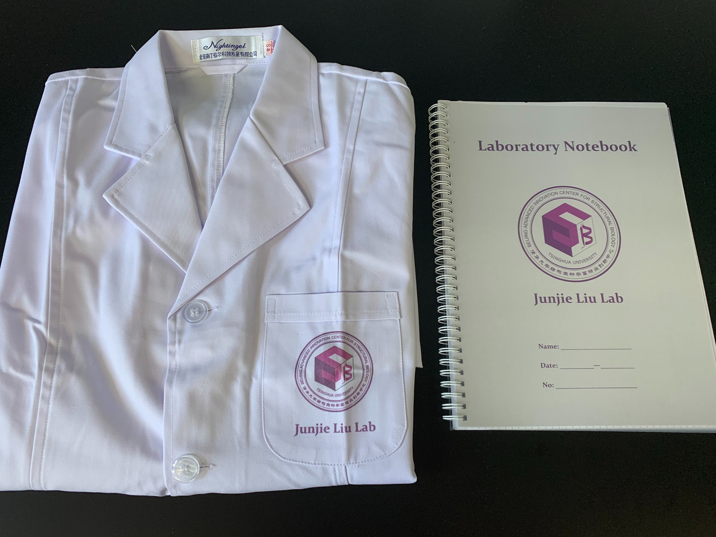 Lab coat and notebook