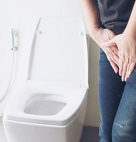 woman-holding-hand-near-toilet-bowl-health-problem-concept.jpg