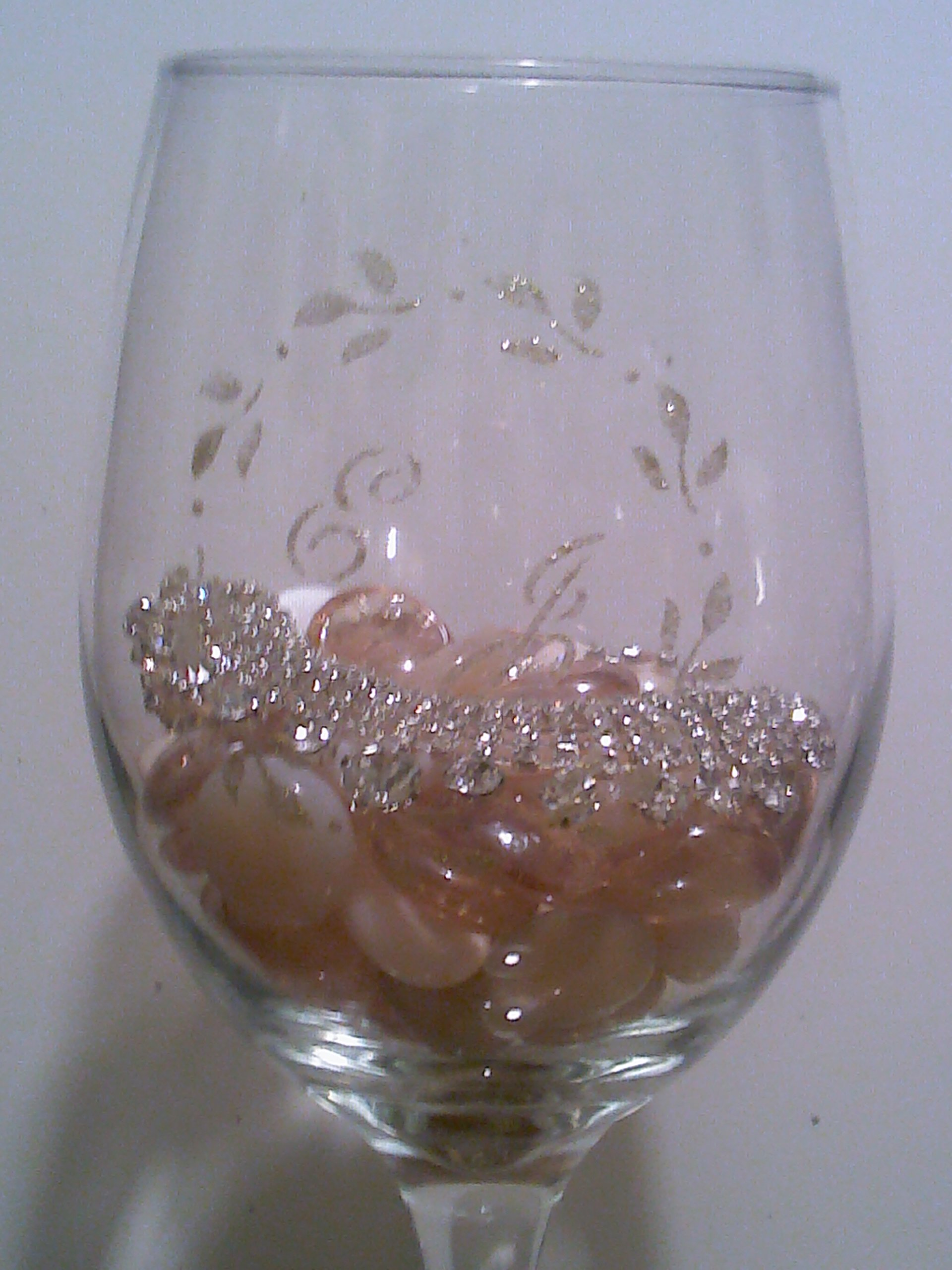 Custom glass holds bridesmaid jewels