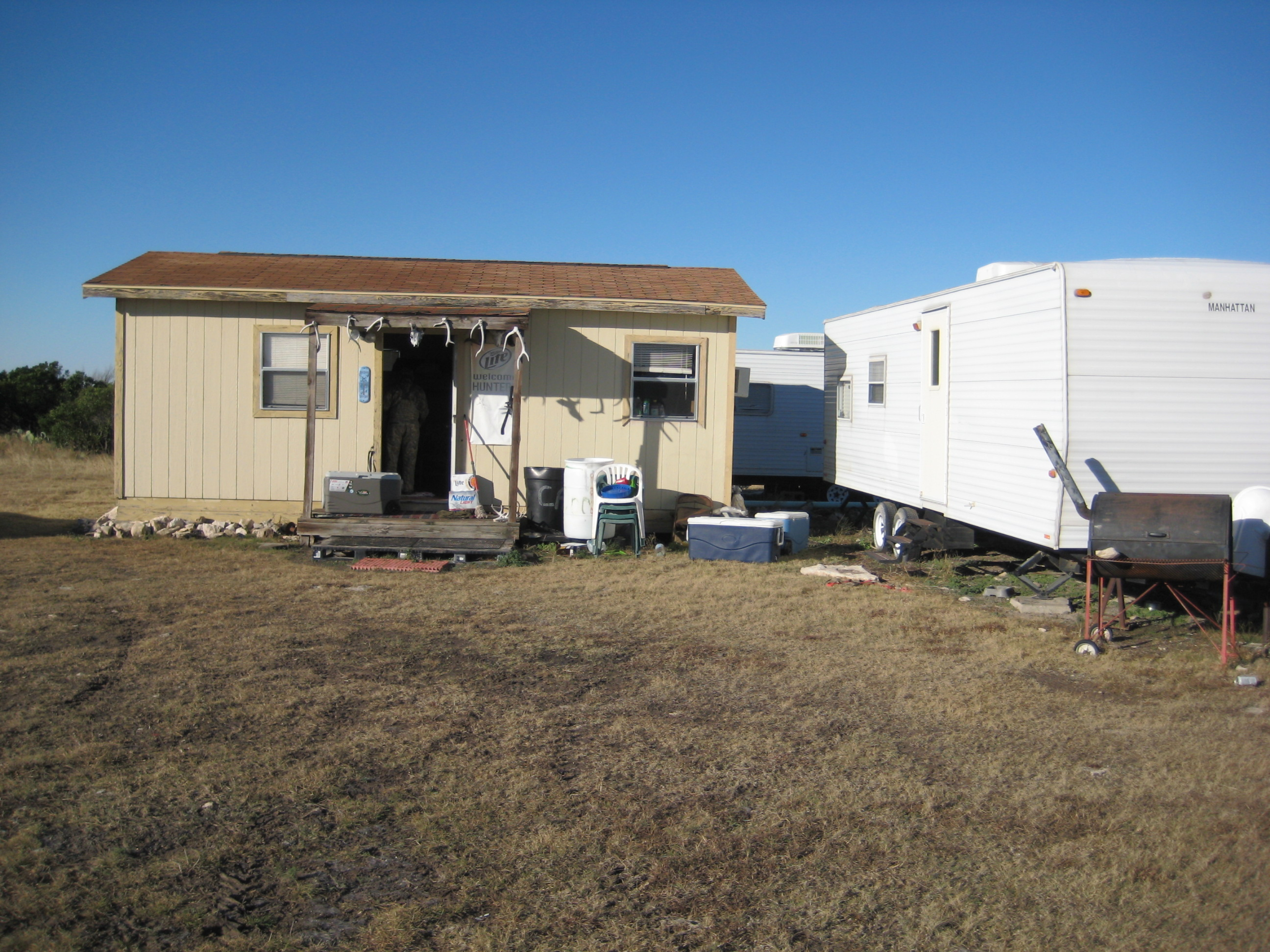 Camp and 32' trailer goes with Property