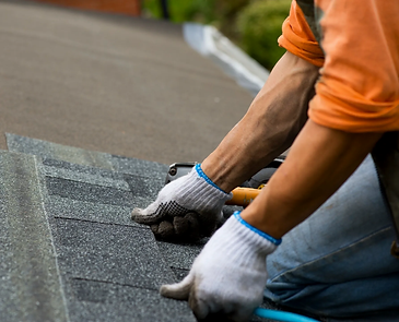 man laying shingles.webp