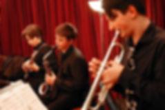 Three studets play blues music