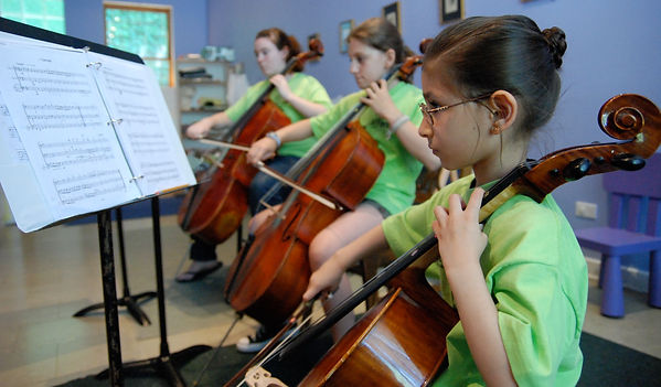 Three students playing cello