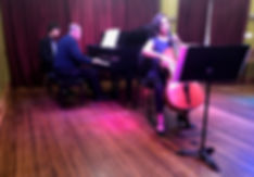 A cellist and pianist play