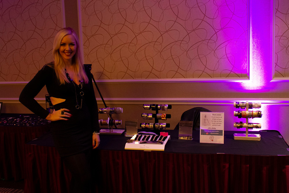 Julie Holiday by her curated table at the Access Jewelry Box event