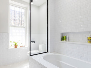 Glass Enclosures Turn Small Baths Grand