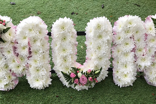 MUM lettering floral display for funerals in white with subtle pink flowers. Created by Portsmouth Florist