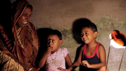 Monowara Sekh teaching her children Misb