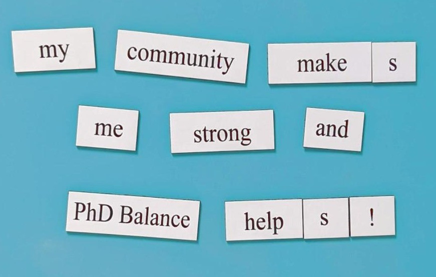 "Word magnets that make the sentence ""my community makes me strong and PhD Balance helps!"