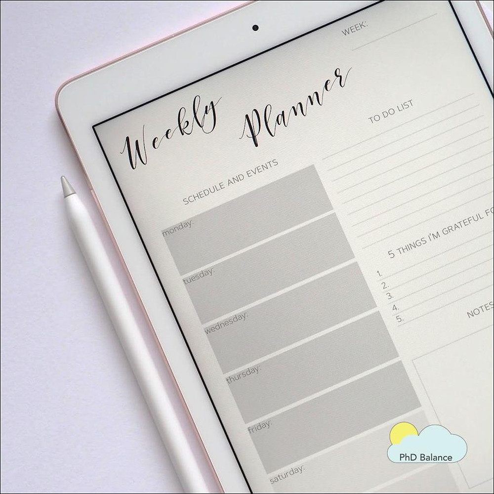 Picture of a white tablet computer and tablet pen. A weekly planner template is open on the screen.