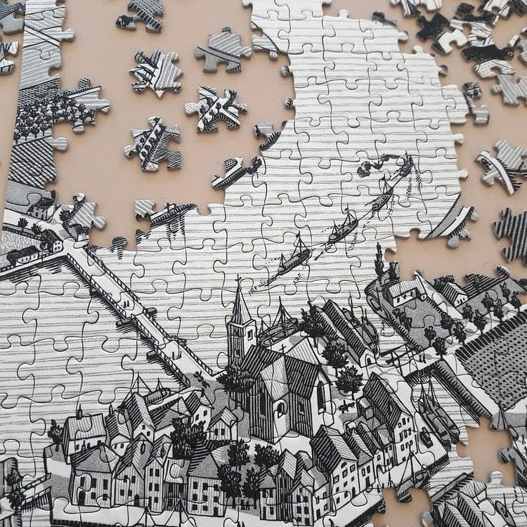 Picture of a partially put together jigsaw puzzle missing pieces.