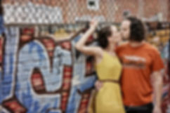 Dramatic engagement portrait grafitti wall and chain link fence, Asheville engagement photographer