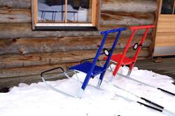 Kicksleds at log cabin Lapland
