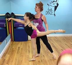 Ms. Julie guiding Strut Your Stuff dancer, Giuliana