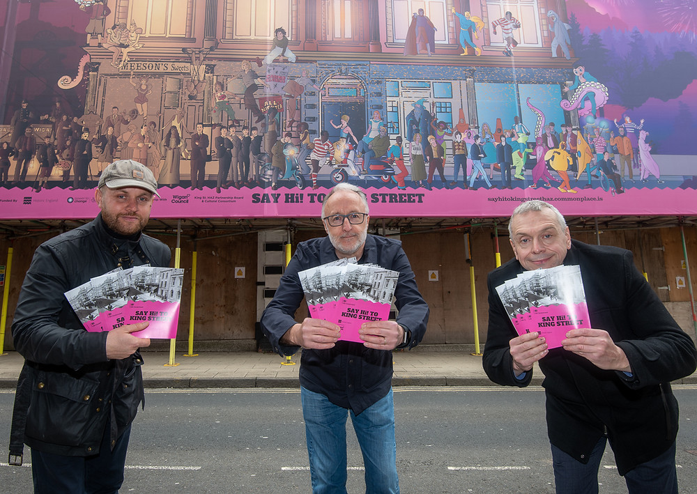 Jonny Davenport, Jim Meehan & Phil Machin stand in front of Dom Foster's artwork at the Royal Court Theatre