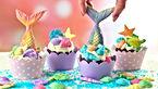 Mermaid theme cupcakes with colorful gli