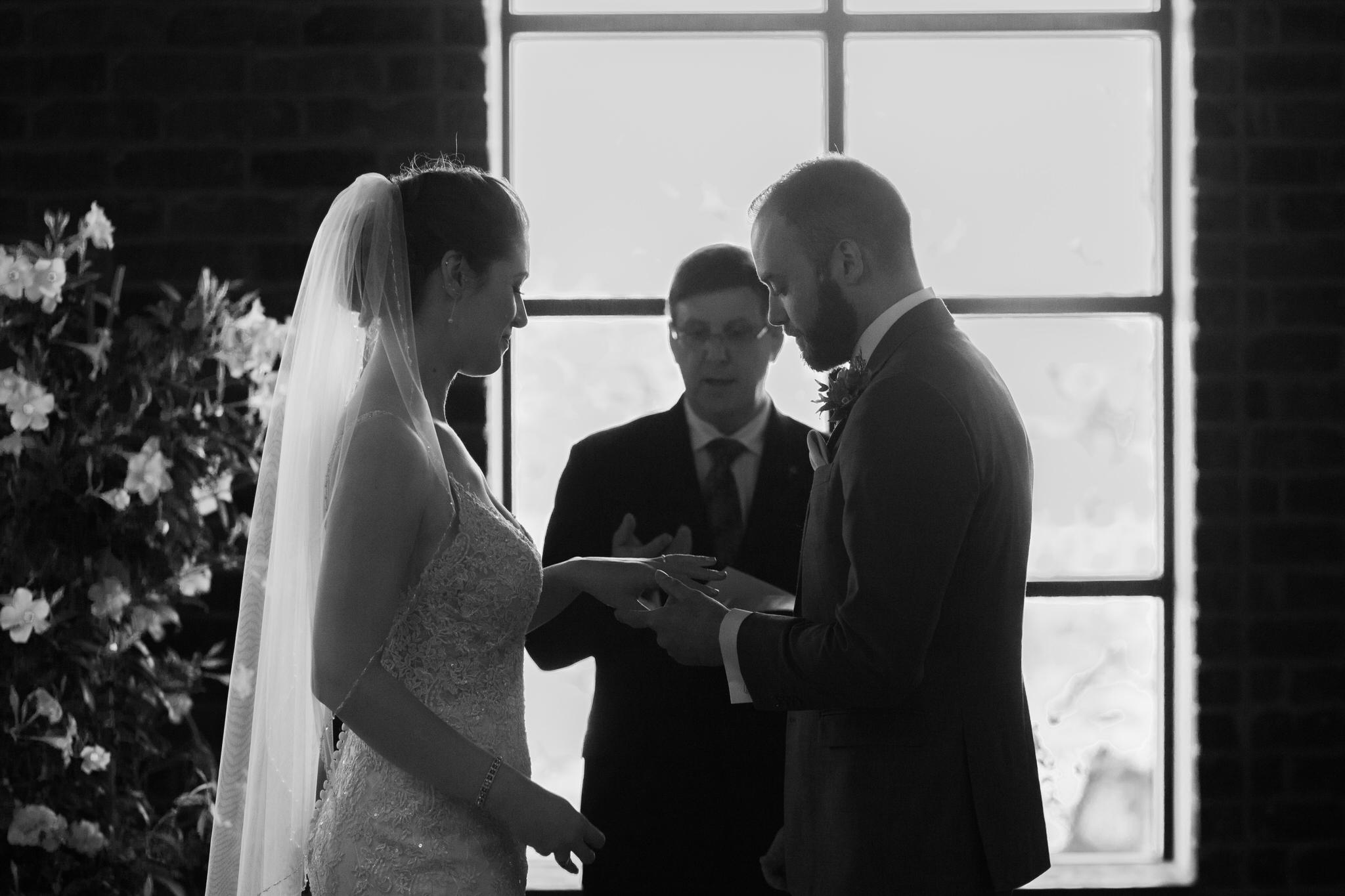 Brock Street Brewery Wedding - exchanging rings