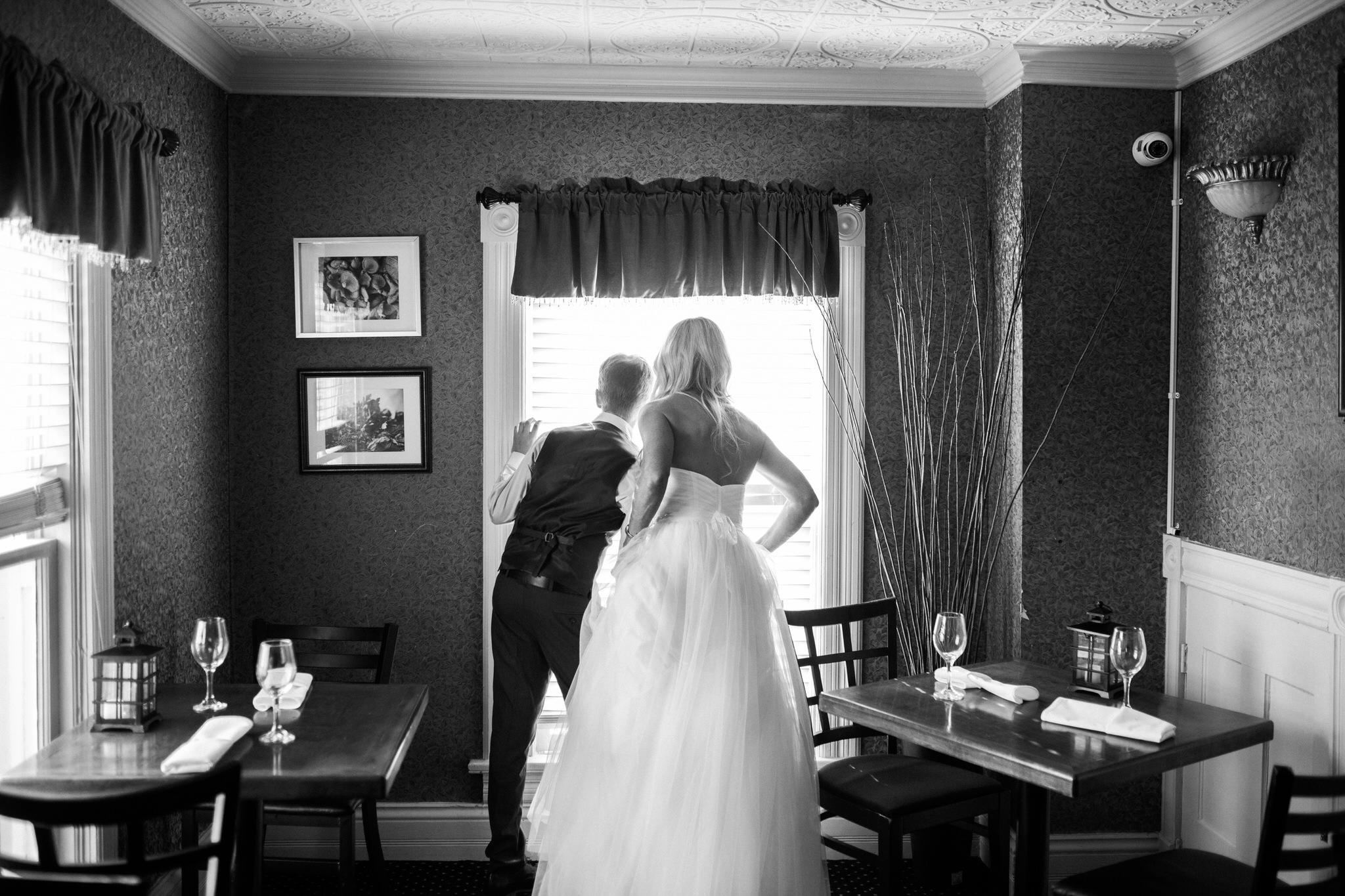 Harvest Restaurant Wedding Brooklin Ontario - Bride and son look out window